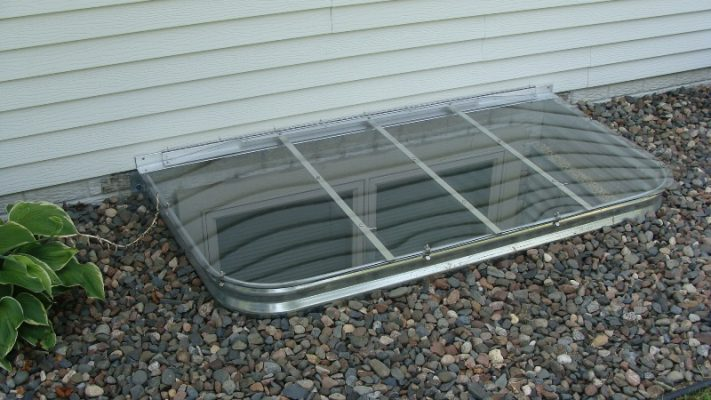 Elongated sloped window well cover