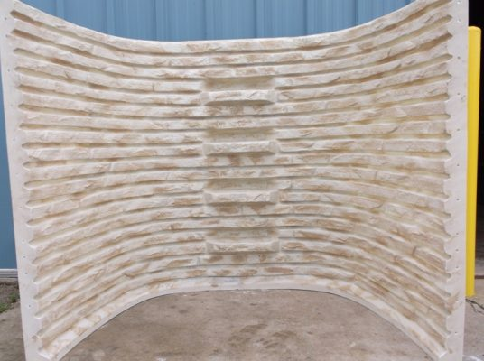 stacked stone basement well in sandstone color