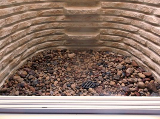 stacked-stone-window-well-installed